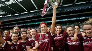 Sarah Dervan holds the league trophy aloft
