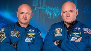 (L-R) Retired astronauts Mark and Scott Kelly