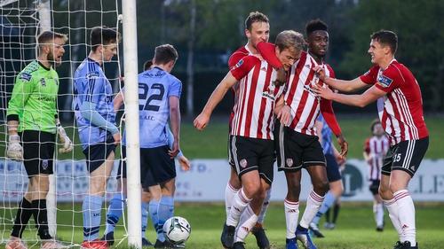 Goal scorer Greg Sloggett is congratulated by Derry City team-mates