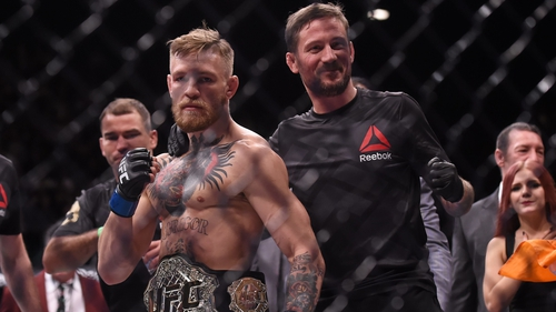 John Kavanagh (R) with Conor McGregor after the fighter won the UFC featherweight belt in 2015