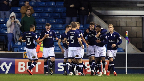 Millwall players celebrate their late equaliser at home to Sheffield United - a goal with big implications for the promotion race