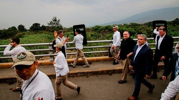 US Secretary of State Mike Pompeo (R, black shirt) and Colombian President Ivan Duque visit the Simon Bolivar International Bridge in Cucuta,, Colombia, on the border with Venezuela