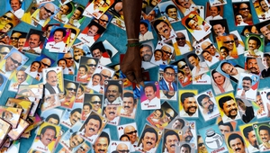 An Indian vendor arranges photos of Dravida Munnetra Kazhagam (DMK) party president M. K. Stalin during an election rallyin Sriperumbudur in the Tamil Nadu state. Photo: Arun Sankar/AFP/Getty Images