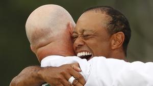 Woods celebrates with caddie Joe LaCava