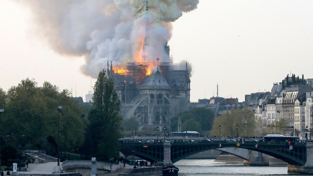 Watch flames destroy famed Notre Dame Cathedral as the historic building burns