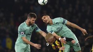 Arsenal's Shkodran Mustaf and Konstantinos get the better of Watford's Will Hughes