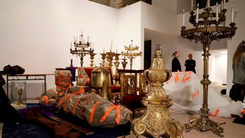 Some of the artworks and relics rescued from Notre-Dame Cathedral at the Hotel de Ville in Paris