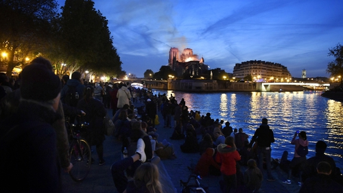 Crowds gathered in disbelief on the banks of the Seine