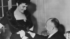 Jane Russell meets Christian Dior in Paris for a fitting of one of Dior's much vaunted 'H' line creations.