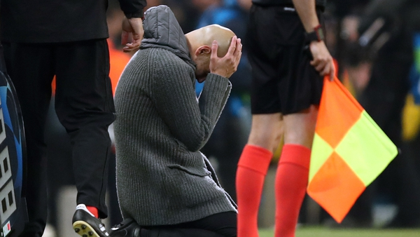 Pep Guardiola slumps to the ground in disbelief
