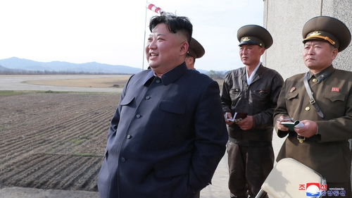 Kim Jong-un overseeing testing of a new tactical weapon last month (file pic)