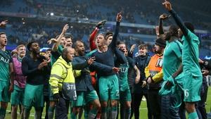 Spurs players celebrate victory at the Etihad Stadium