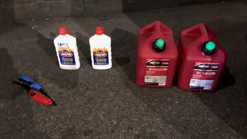 Petrol cans, lighter fluid and butane lighters were found by police (Pic: @NYPDnews)