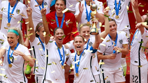 USA captain Carli Lloyd hoists the World Cup trophy following the 5-2 victory over Japan in the 2015 final