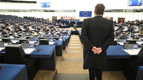 An usher watches the debate on the future of the EU at the European Parliament in Strasbourg