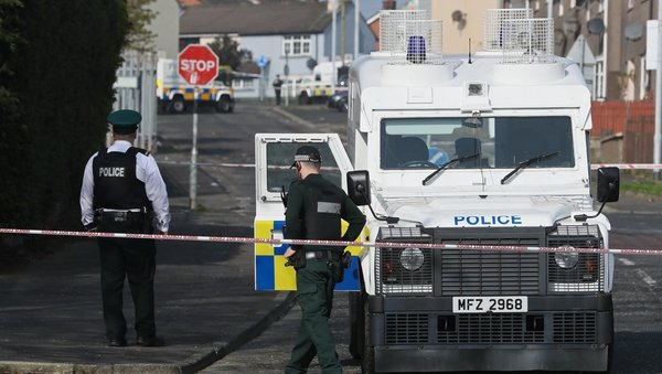Police at the scene in Derry where Lyra McKee was shot