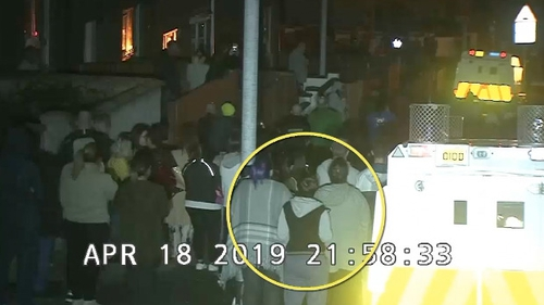 The CCTV footage shows Lyra McKee in the crowd last night