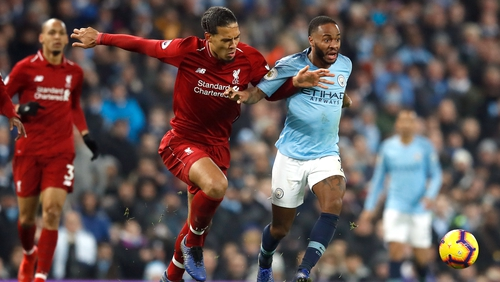 Virgil Van Dijk and Raheem Sterling in action at Anfield
