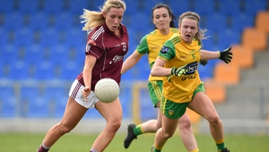 Megan Glynn of Galway in action against Niamh Carr of Donegal