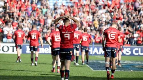 Munster players dejected at the final whistle