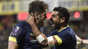 Clermont's centre Damian Penaud (L) celebrates with Wesley Fofana
