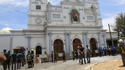 Security personnel stand guard after a explosion hit at St Anthony's Church in Kochchikade in Colombo