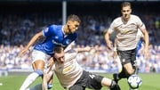 Everton's Dominic Calvert-Lewin  in action with Manchester United's Phil Jones