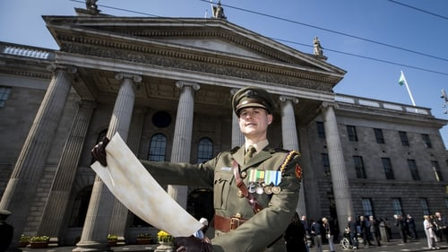 Defence forces Captain Paul Conlon read the proclamation in front of the GPO