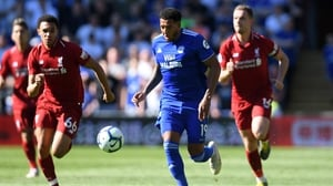 Nathaniel Mendez-Laing of Cardiff City evades Trent Alexander-Arnold and Jordan Henderson