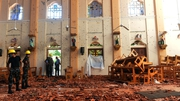 Security personnel inspect the interior of St Sebastian's Church in Negombo