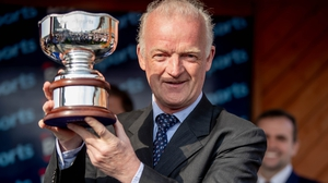 Willie Mullins with the trophy