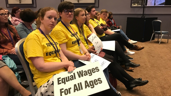Primary school teachers make their point with placards at the INTO congress in Galway in April 2019