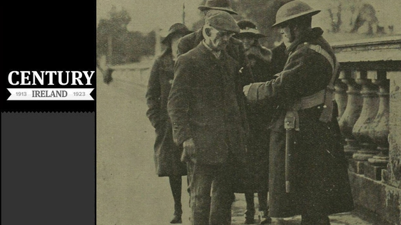 Century Ireland Issue 151 - A sentry checking permits as people re-enter the city Photo: Illustrated London News [London, England], 26 April 1919