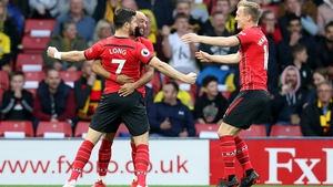 Shane Long (7) celebrates with his team mates after opening the scoring