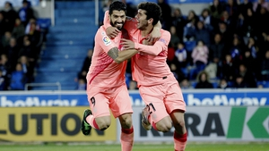 Goalscorers Luis Suarez (L) and Carles Alena celebrate