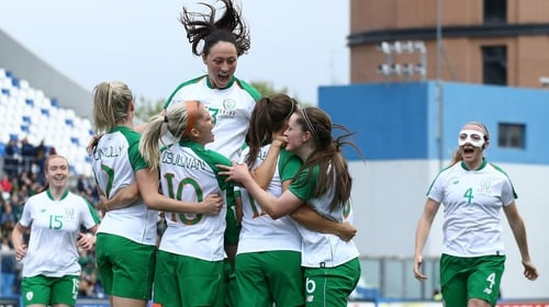 Ireland's Katie McCabe is mobbed after scoring against Italy