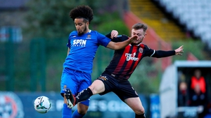 Bohemians' Conor Levingston with Bastien Héry of Waterford