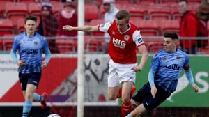 St Patrick's Chris Forrester with Gary O'Neill of UCD