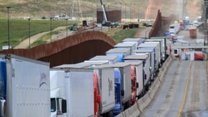 Hundreds of trucks line up to cross into the US at the Otay Mesa checkpoint in Tijuana, Mexico