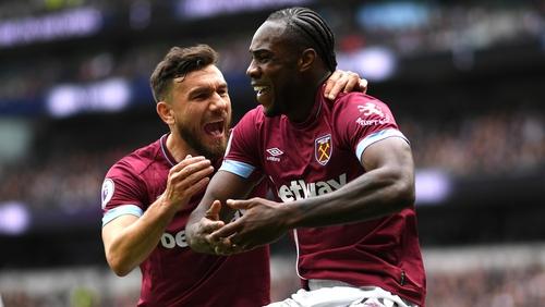 Michail Antonio of West Ham United celebrates with teammate Robert Snodgrass
