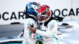 Valtteri Bottas and Lewis Hamilton embrace
