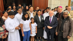 President Michael D Higgins and Archbishop Diarmuid Martin with members of the Sri Lankan community