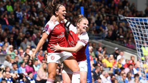 Katie McCabe celebrates scoring Arsenal's second goal with captain Kim Little