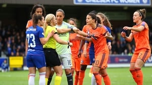 Players surround referee Sara Persson