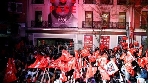 Supporters of the Socialist Workers' Party (PSOE) gather outside the party's headquarters in Madrid