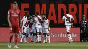 Rayo Vallecano players celebrate the only goal of the game