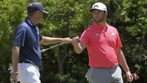 Ryan Palmer and Jon Rahm fist bump on the fourth hole on the final round in New Orleans
