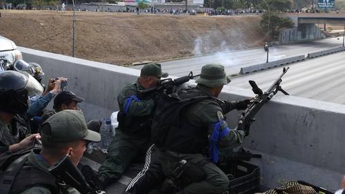 Soldiers loyal to Juan Guaido take position in front of La Carlota base in Caracas
