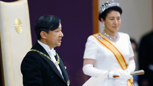 Japan's new Emperor Naruhito makes an address, alongside his wife Empress Masako, after the accession to the throne at the Imperial Palace in Tokyo