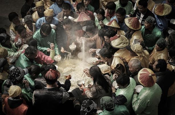 Noodles in a large cauldron